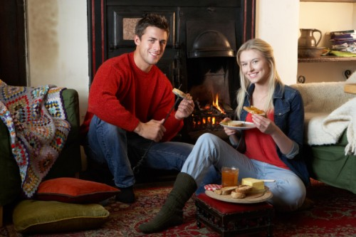 "Quick caption sidebar: this is one of the images that came up when I did a paid image search for ""Staycation."" I have NEVER had a stay-at-home vacation that looked anything like this. Why are they so happy? Because they DIDN'T go to Paris? Are they making fireplace toast? Is that a white people thing? This image just depressed me far more than having multiple staycations ever could. [/End of Sidebar]"